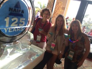 Real Wealth Team members Joanne, Angela and Jenny enjoying a 'blue martini' to celebrate 125 years of NAIFA
